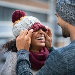 young couple laughing in the winter