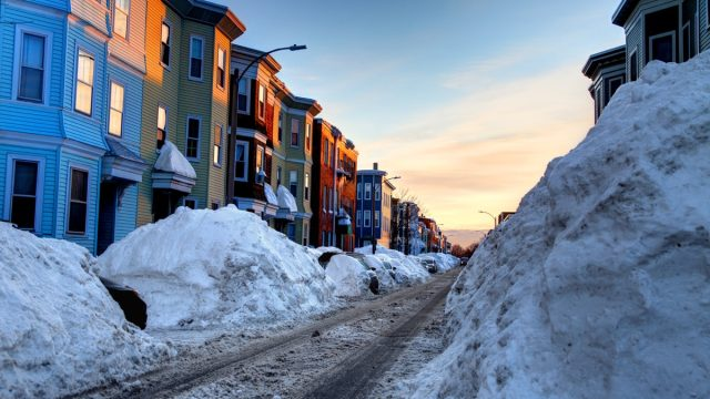 Large snowbanks in the South Boston Southie neighborhood of Boston. Boston is the largest city in New England, the capital of the state of Massachusetts.