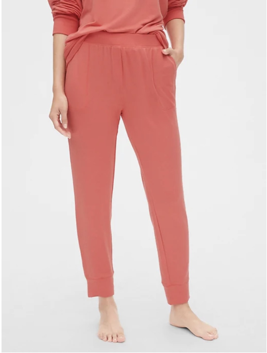 white woman wearing pink pants and top