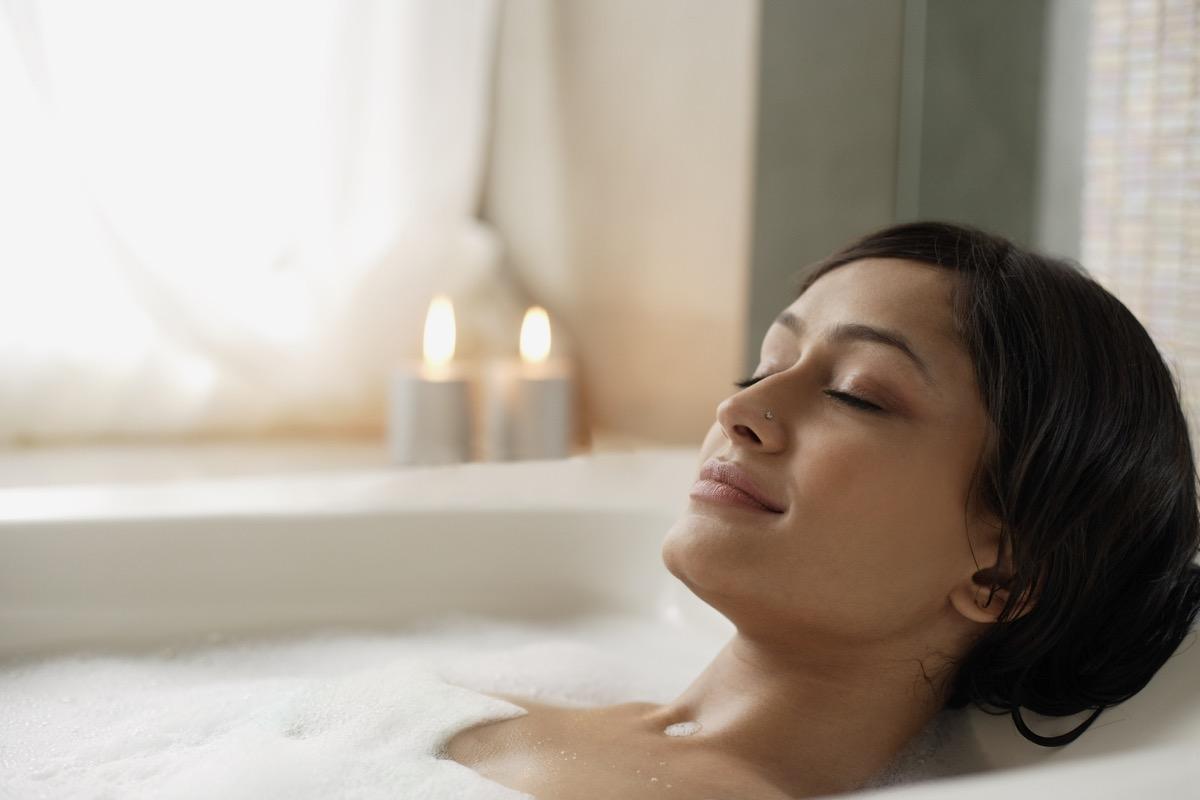 woman taking a relaxing hot bath