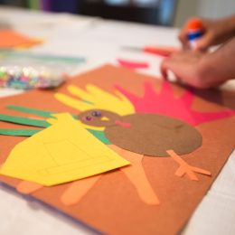child assembling thanksgiving arts and crafts while playing thanksgiving games