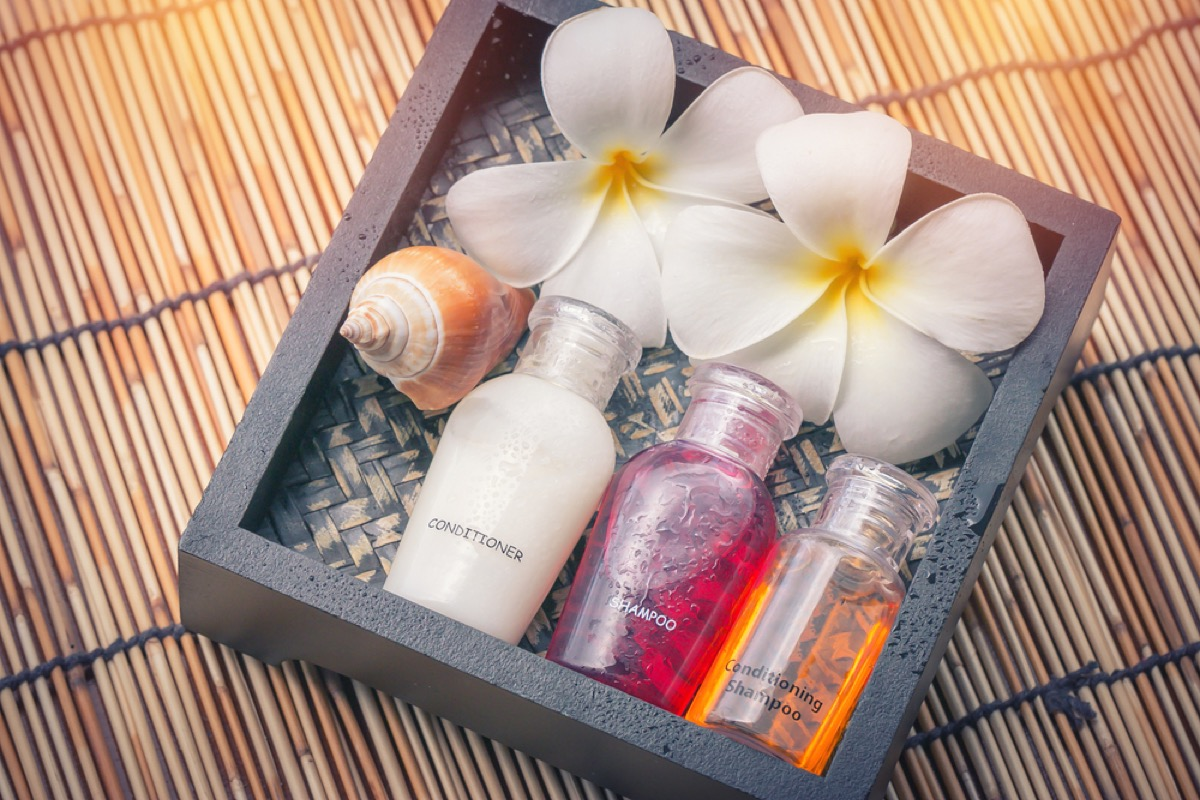 set of travel toiletries with flowers and seashells