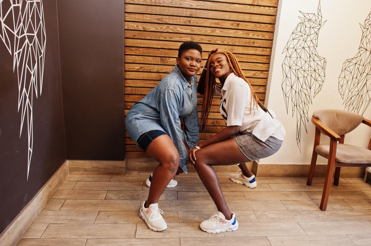 two girls demonstrating twerk dance moves
