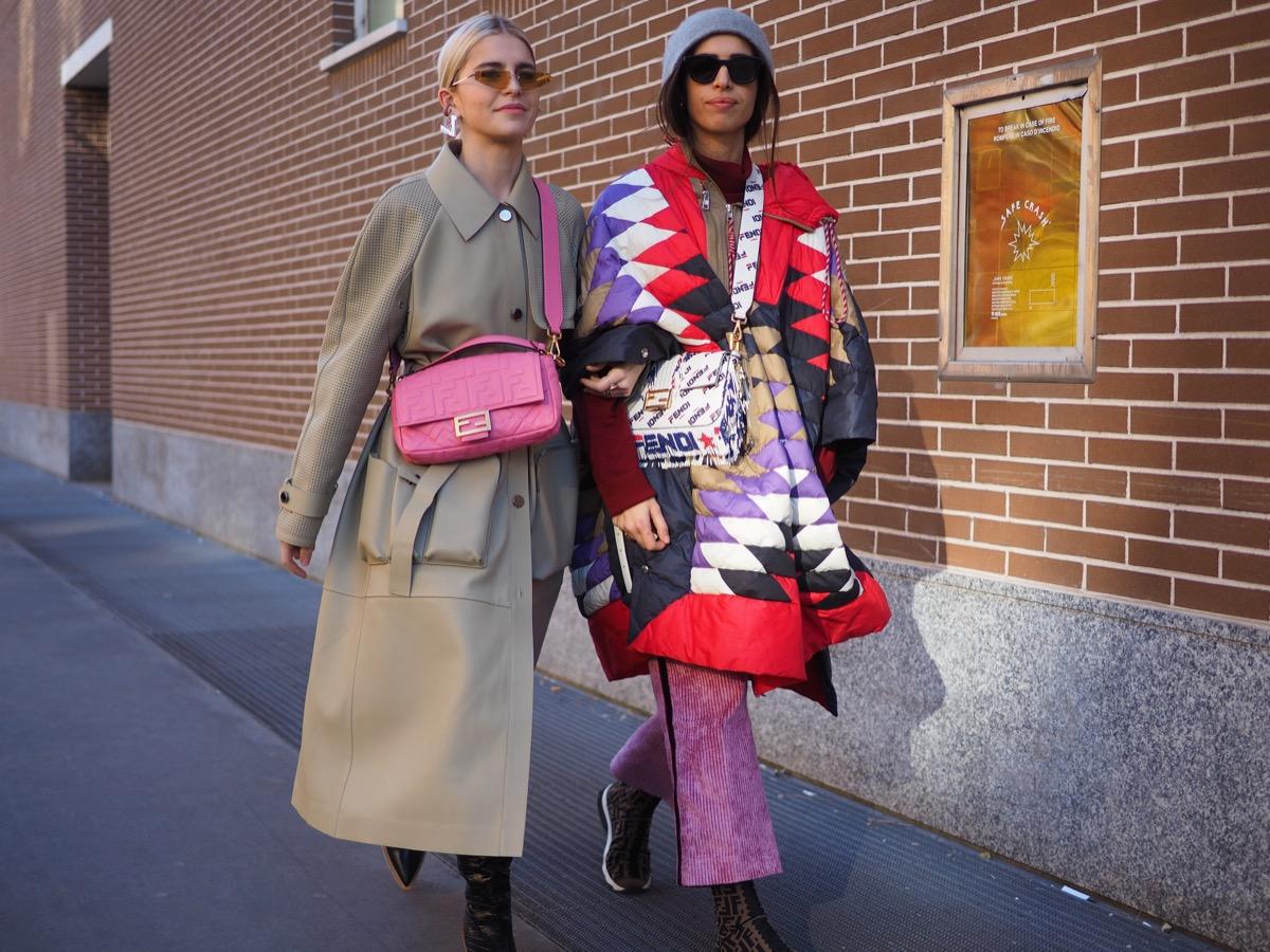 two women dressed in winter coats