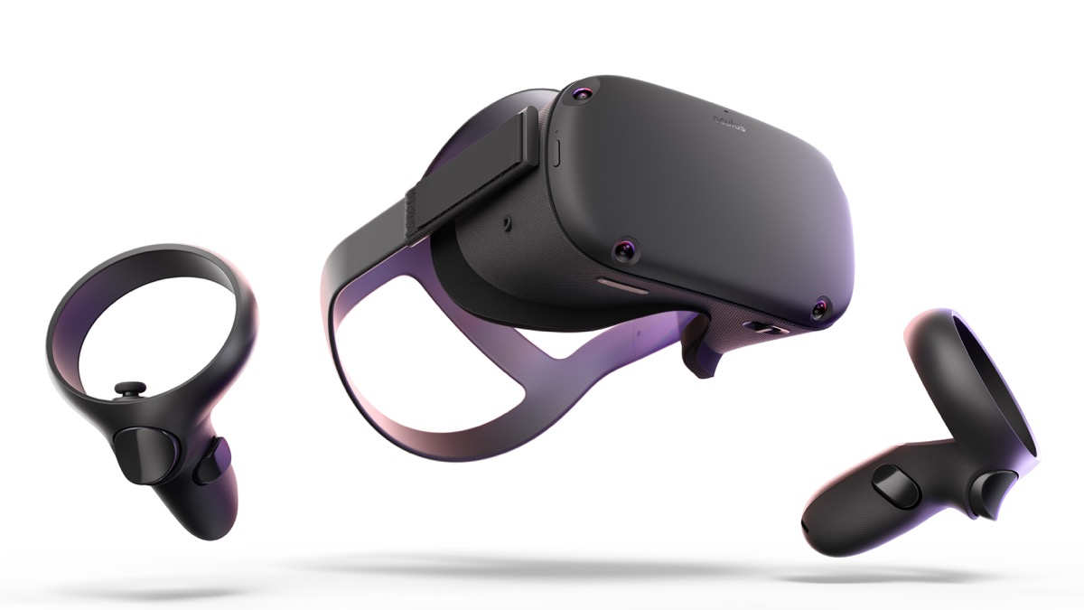 oculus vr headseat and two black controllers