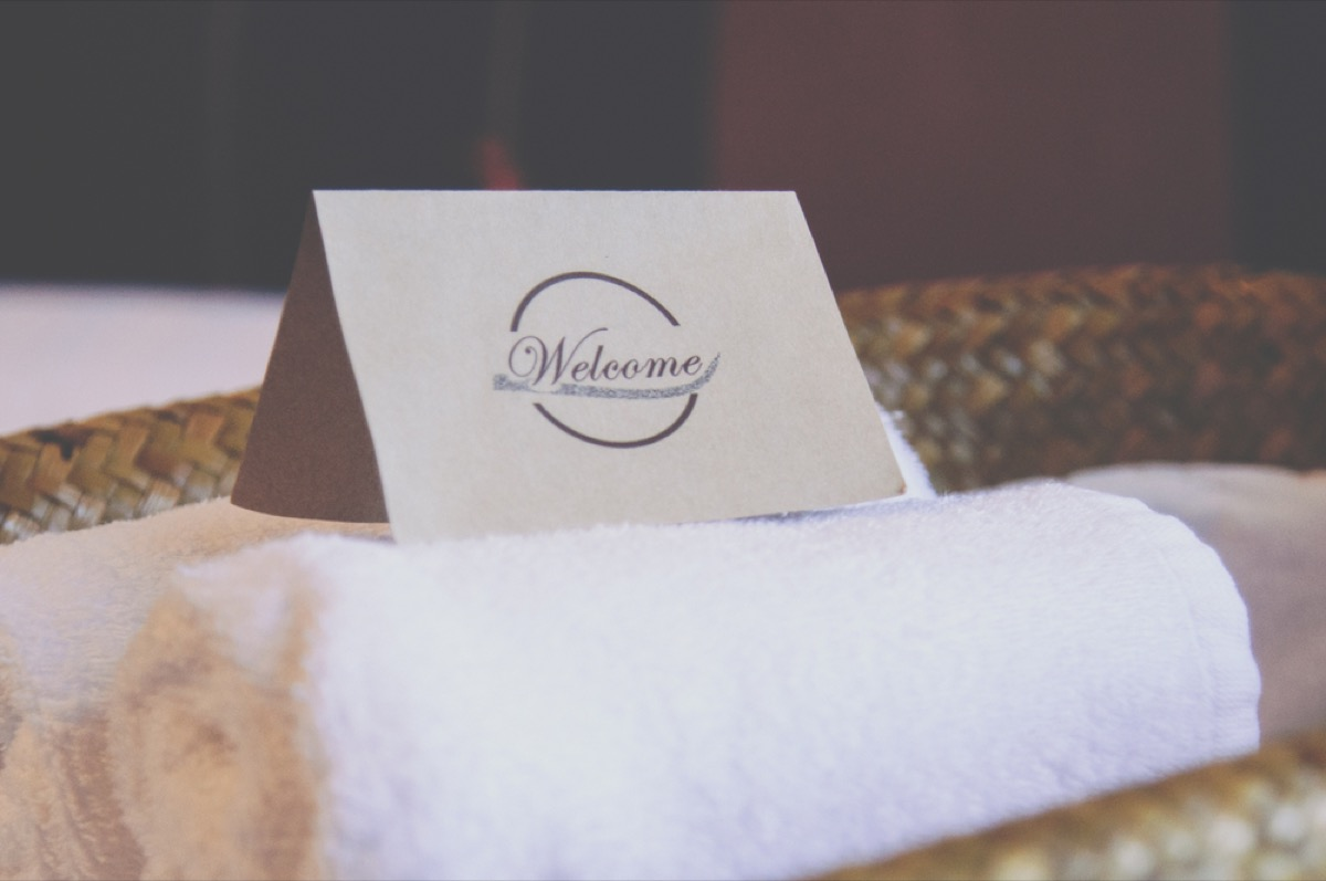 welcome note on white towel