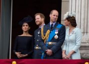 Meghan, Harry, William, and Kate watch the RAF 100 celebrations from the balcony at Buckingham palace.