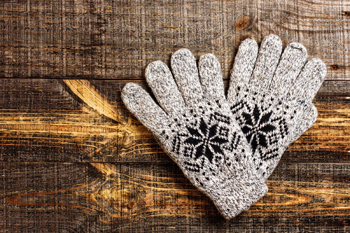 gray winter gloves with black snowflake pattern