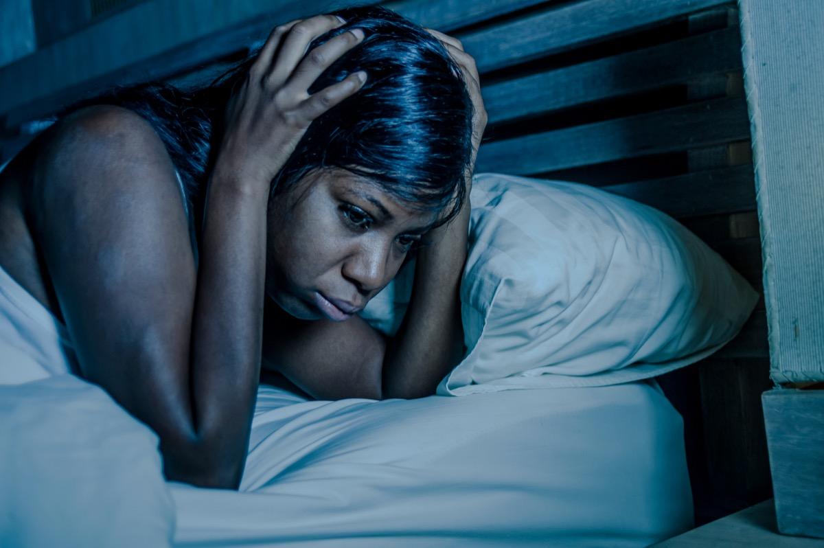 Woman awake and sad in bed