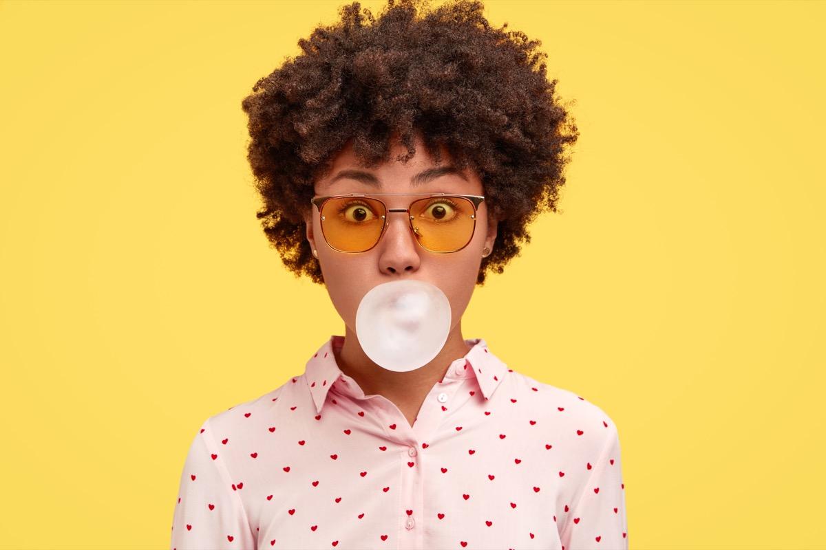 woman blowing gum bubble