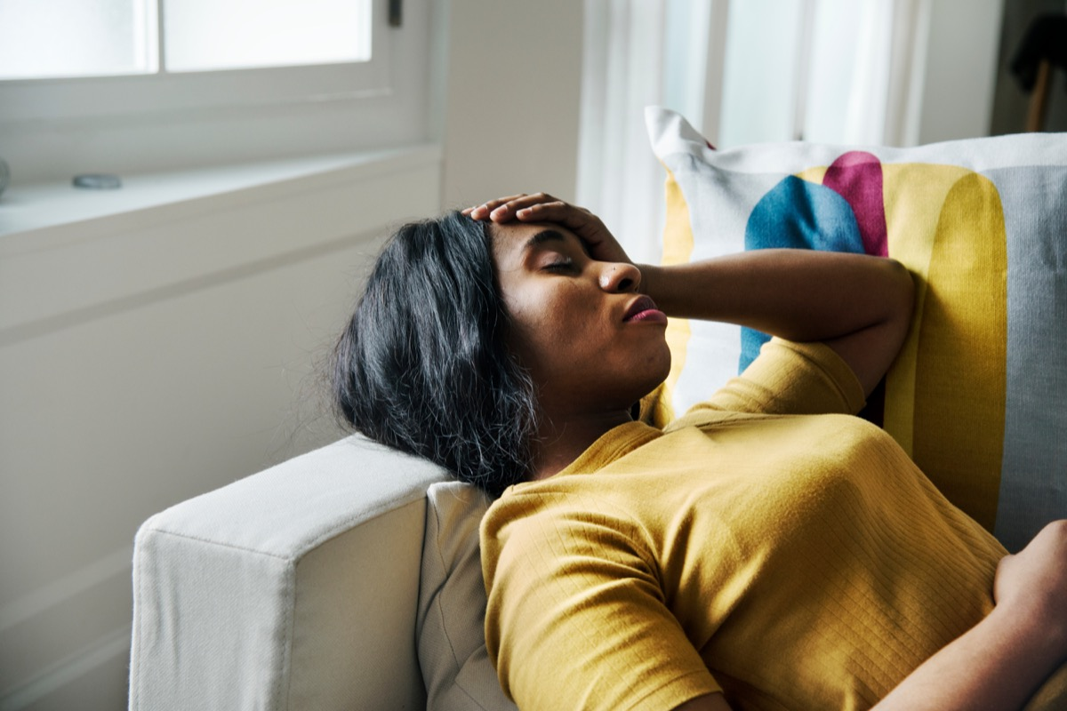 Woman on the couch with a headache