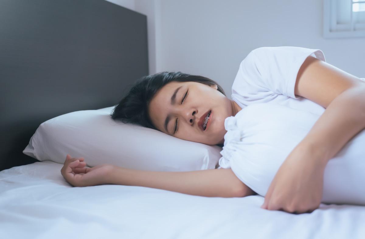 woman grinding teeth in bed