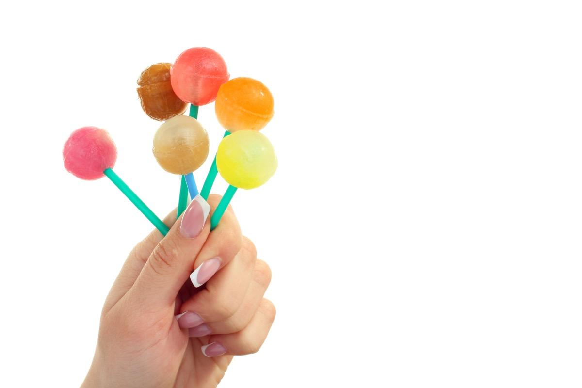 Woman holding lollipops