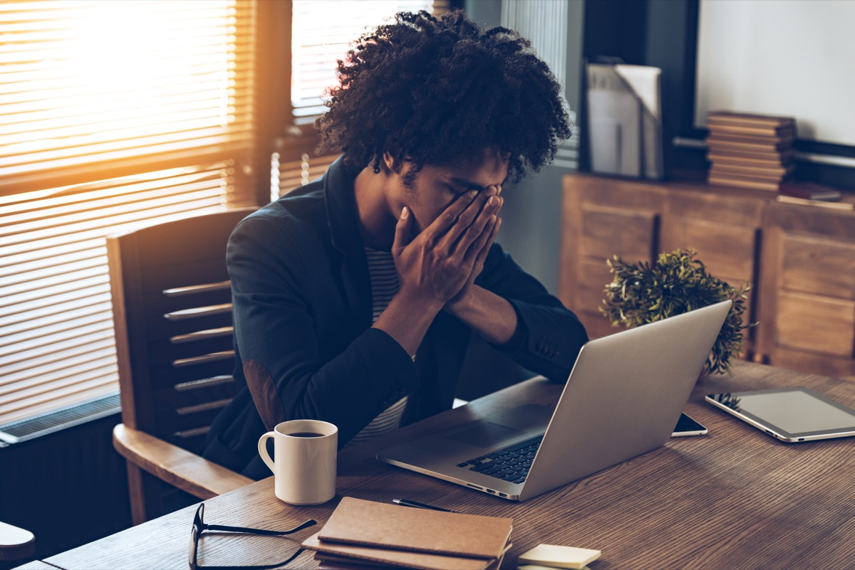 Woman at her desk looking stressed out
