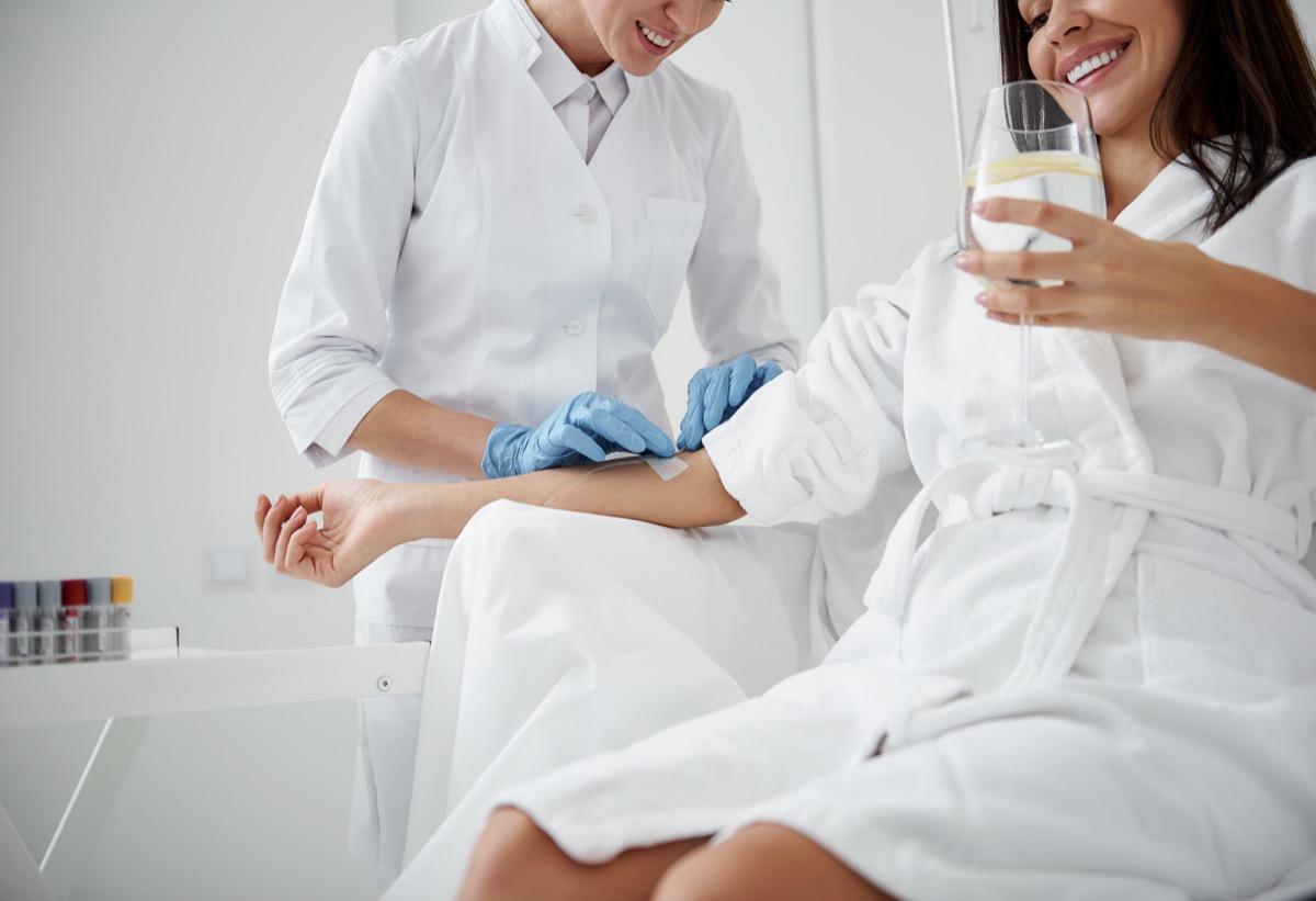 Woman receiving an IV drip
