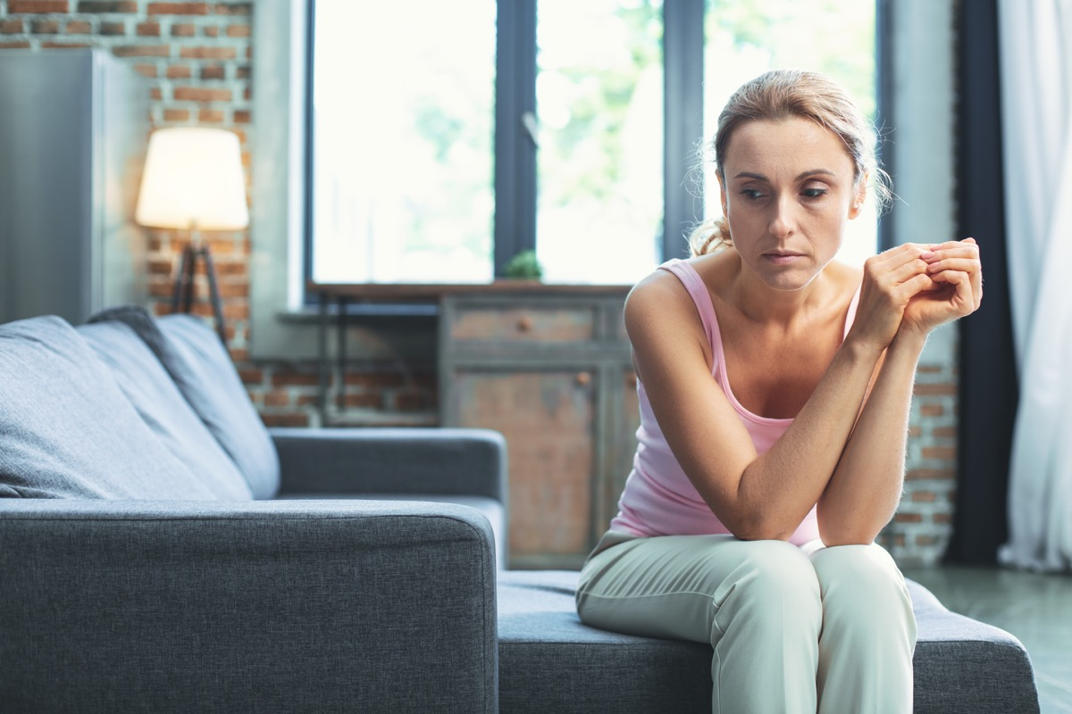Woman looking sad and unmotivated on the couch