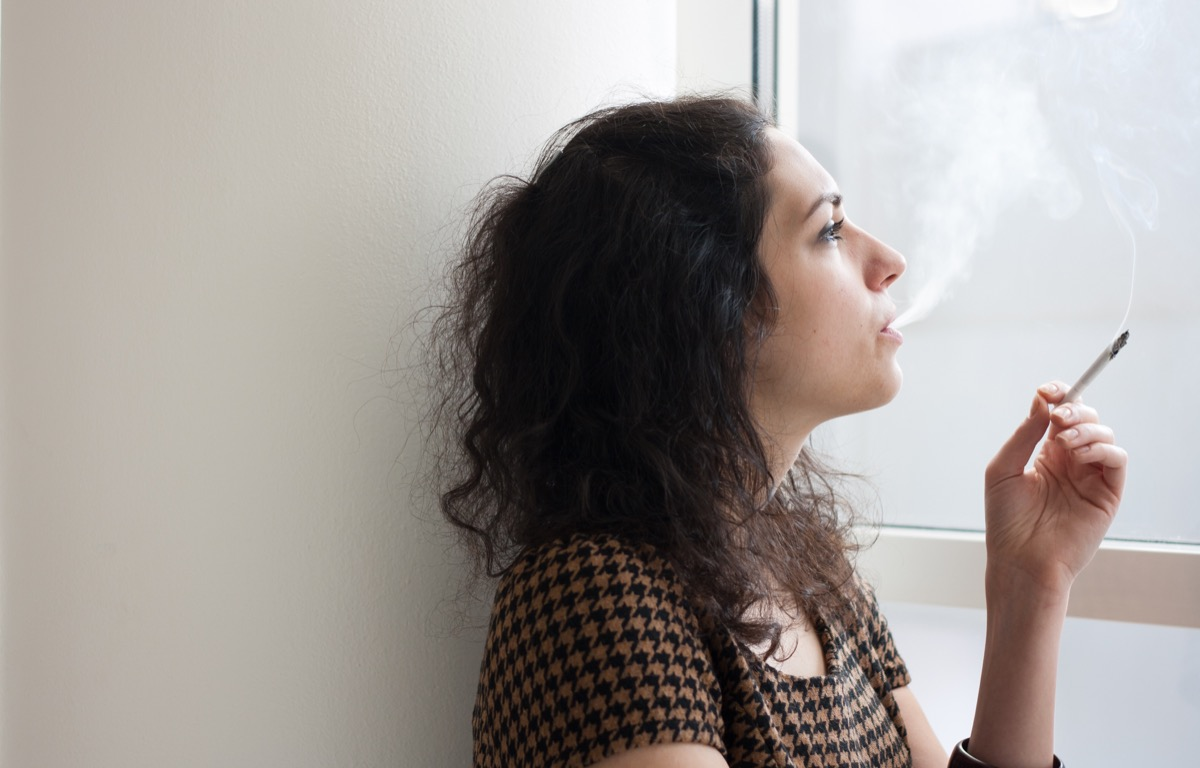woman smoking indoors