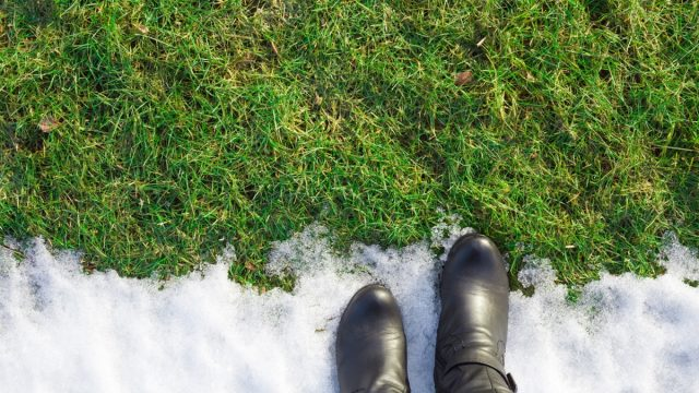 woman standing with boots on in a snow filled yard