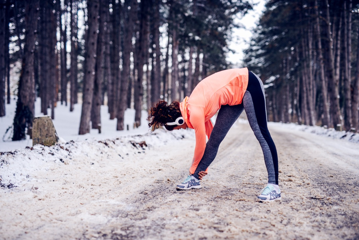 woman stretching in the winter