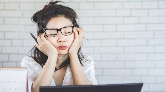 young-woman-sleeping-at-her-desk