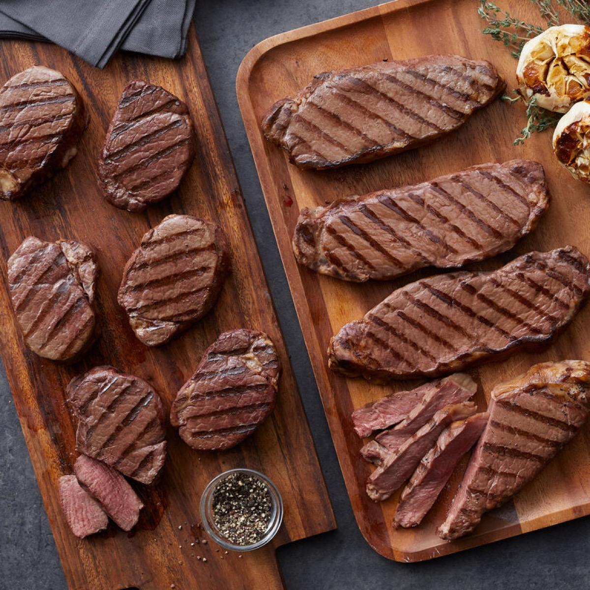 gourmet steaks on cutting boards