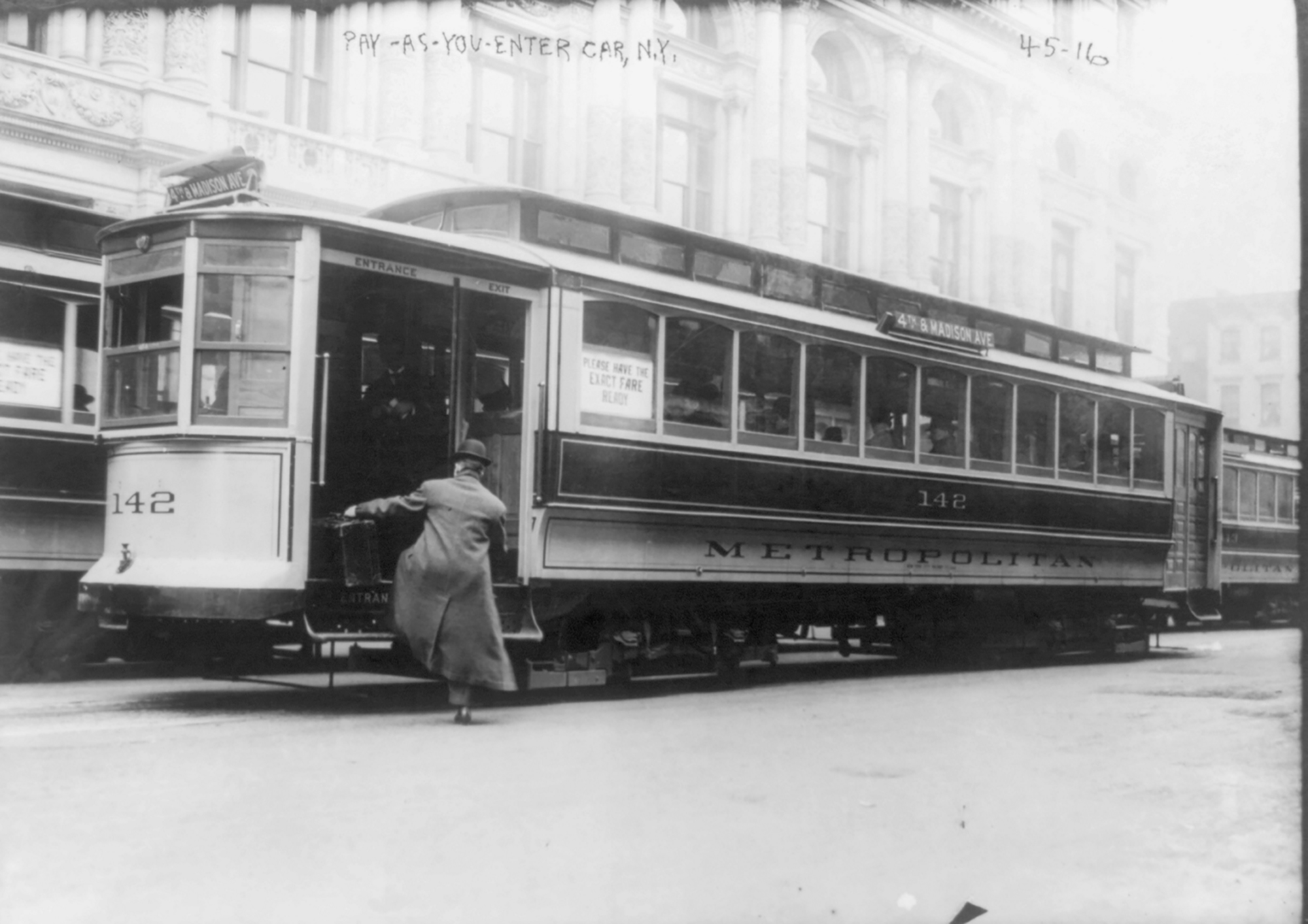 a man gets on a streetcar in new york