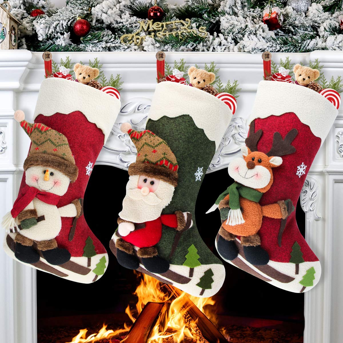 three stockings with 3d winter characters hung on mantle