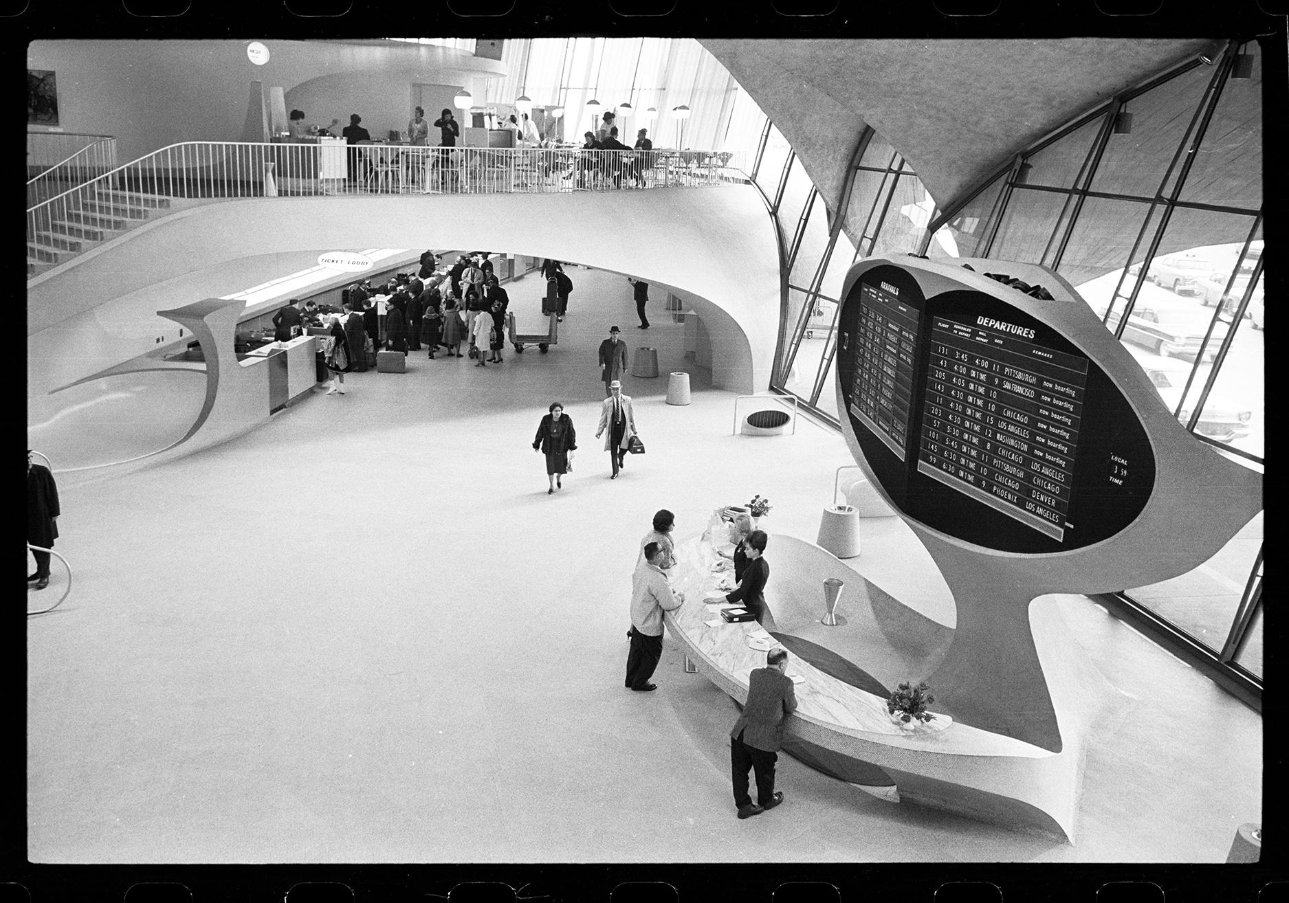 travelers walk through an airport