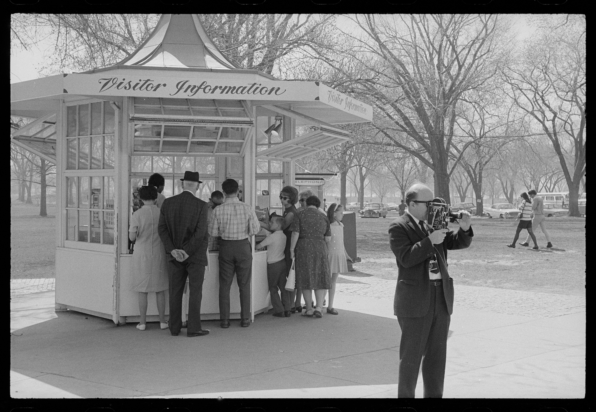 a group of people approach an information booth