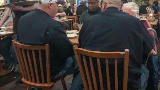 strangers dine with elderly woman at cracker barrel