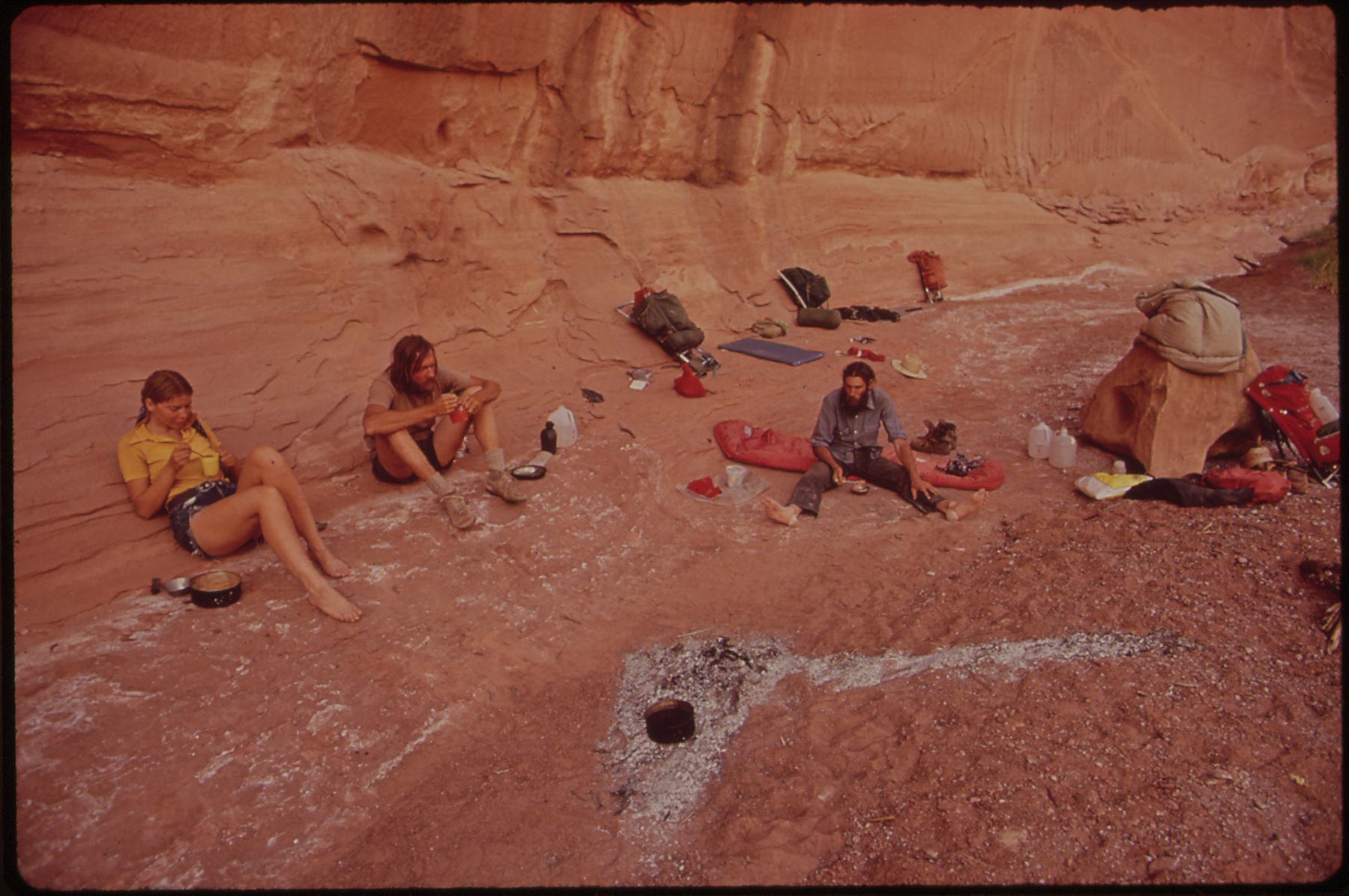 a group of campers sit in a canyon