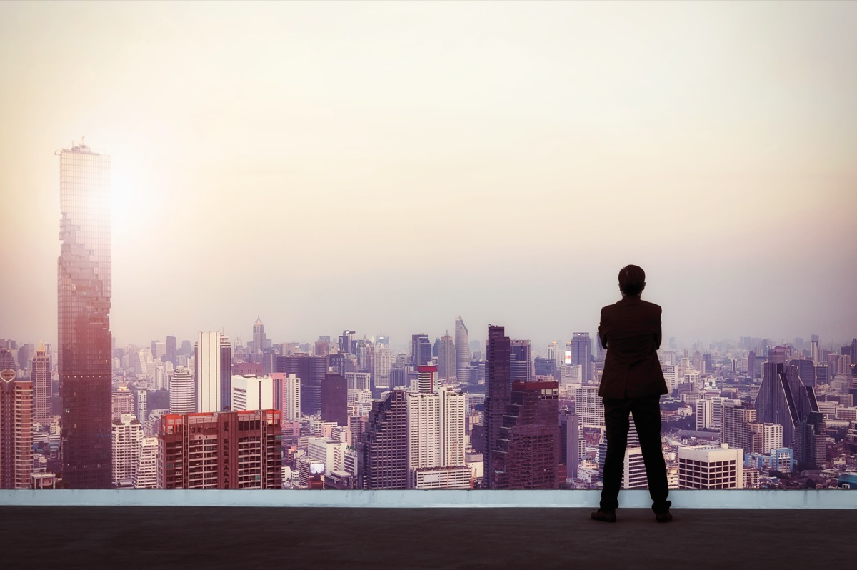 Businessman looking out on city