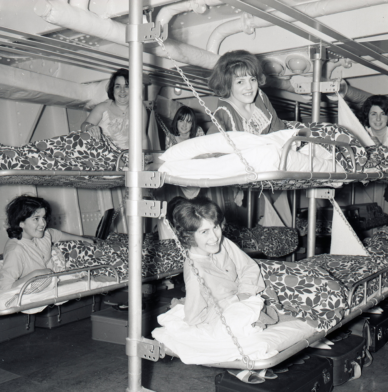 six women sleep on bunk bets in a vintage cruise ship