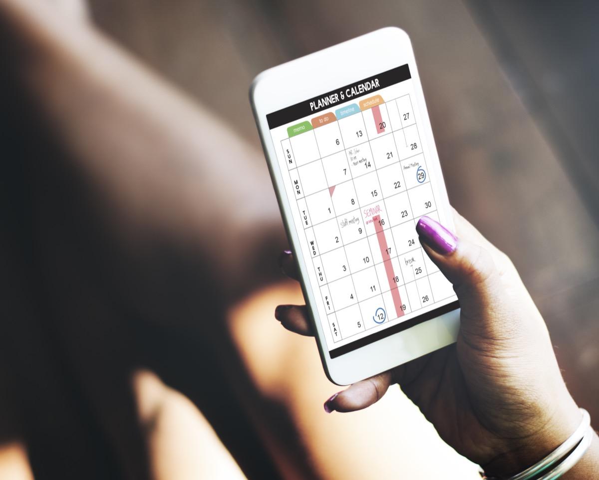 Woman using calendar on her smartphone