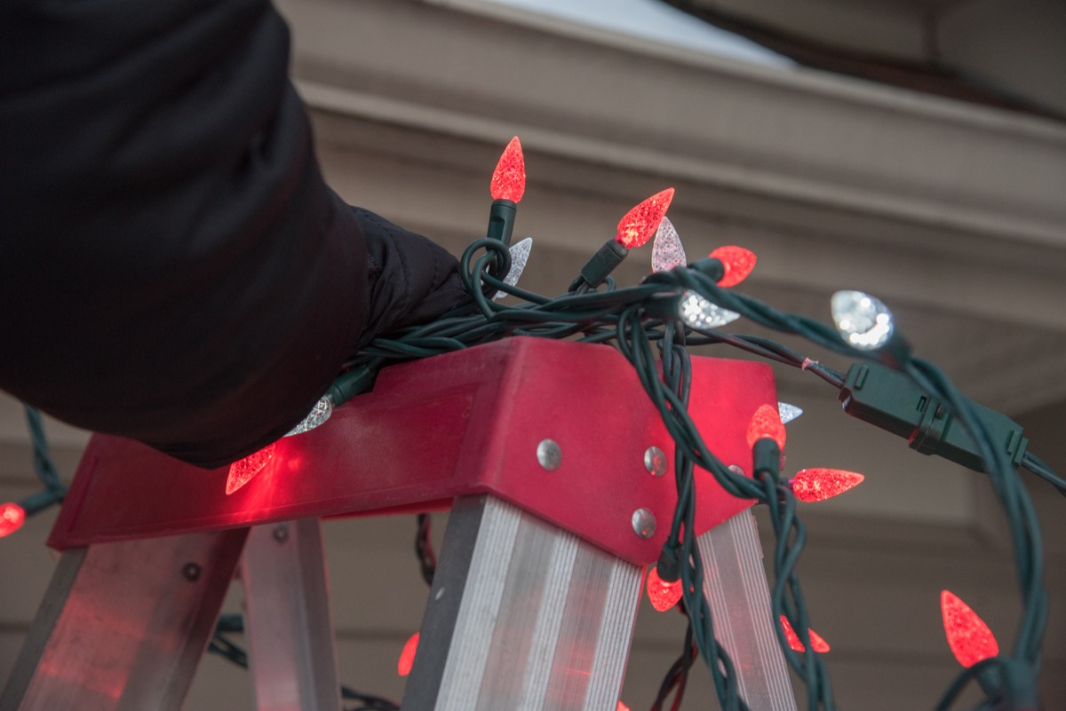 christmas lights on top of a ladder