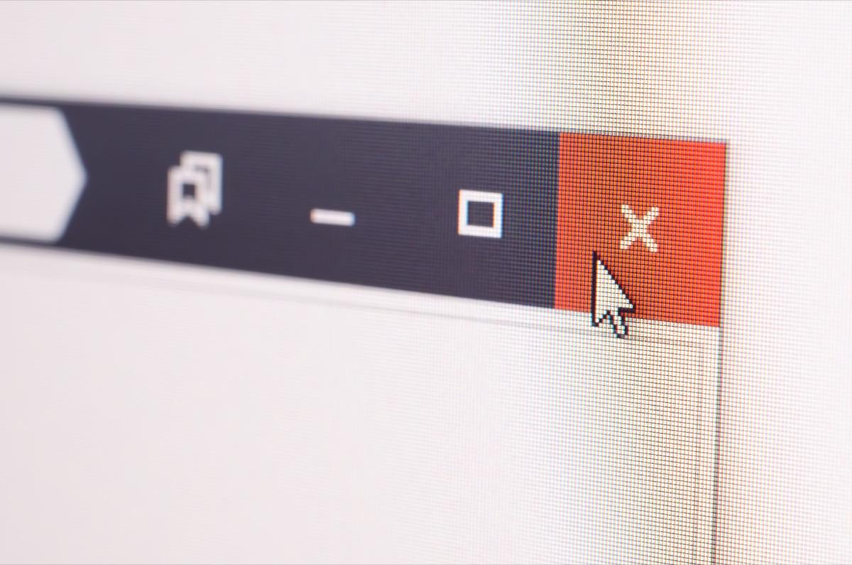 Close up of cursor closing a webpage