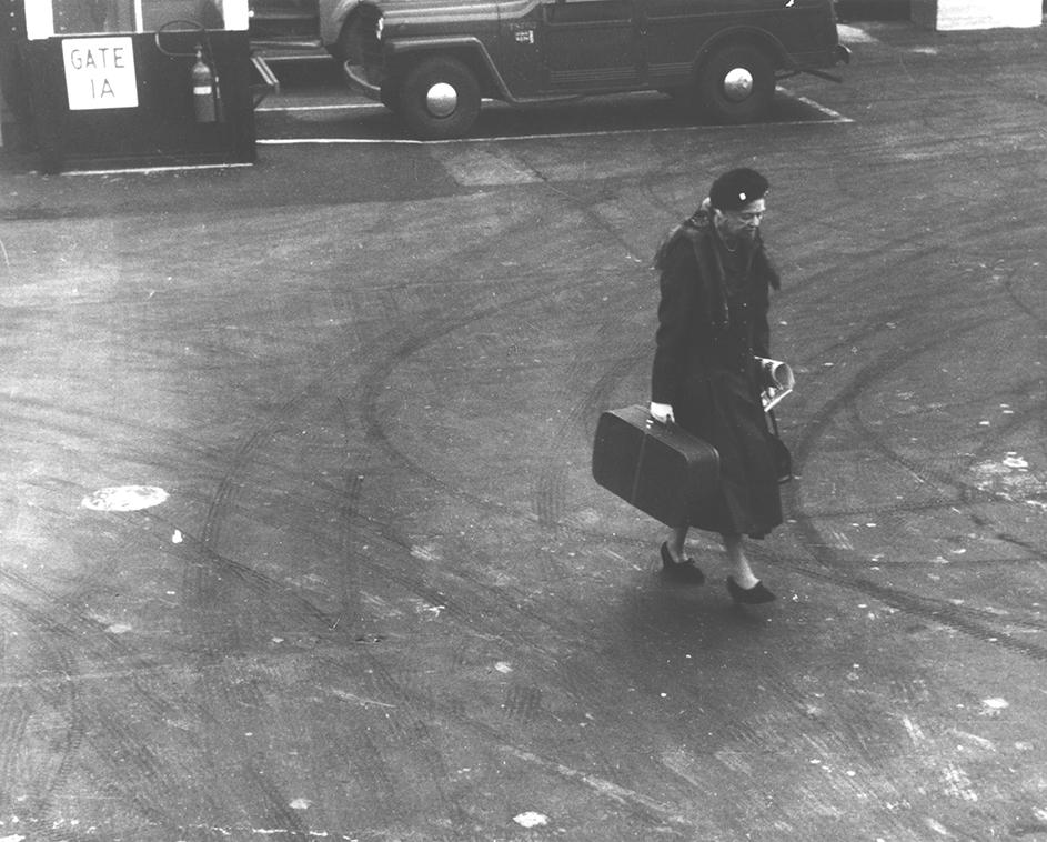 Eleanor Roosevelt walks on a tarmac