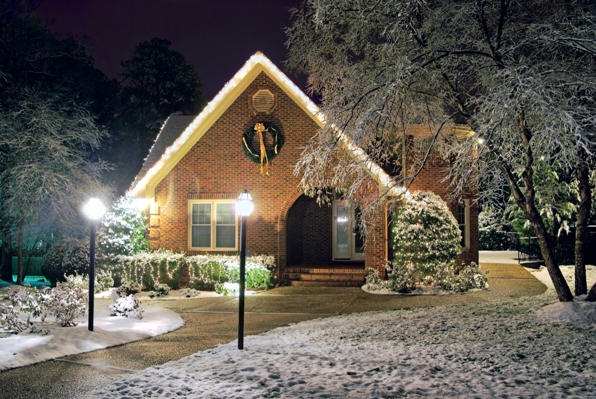 house with exterior lighting in winter