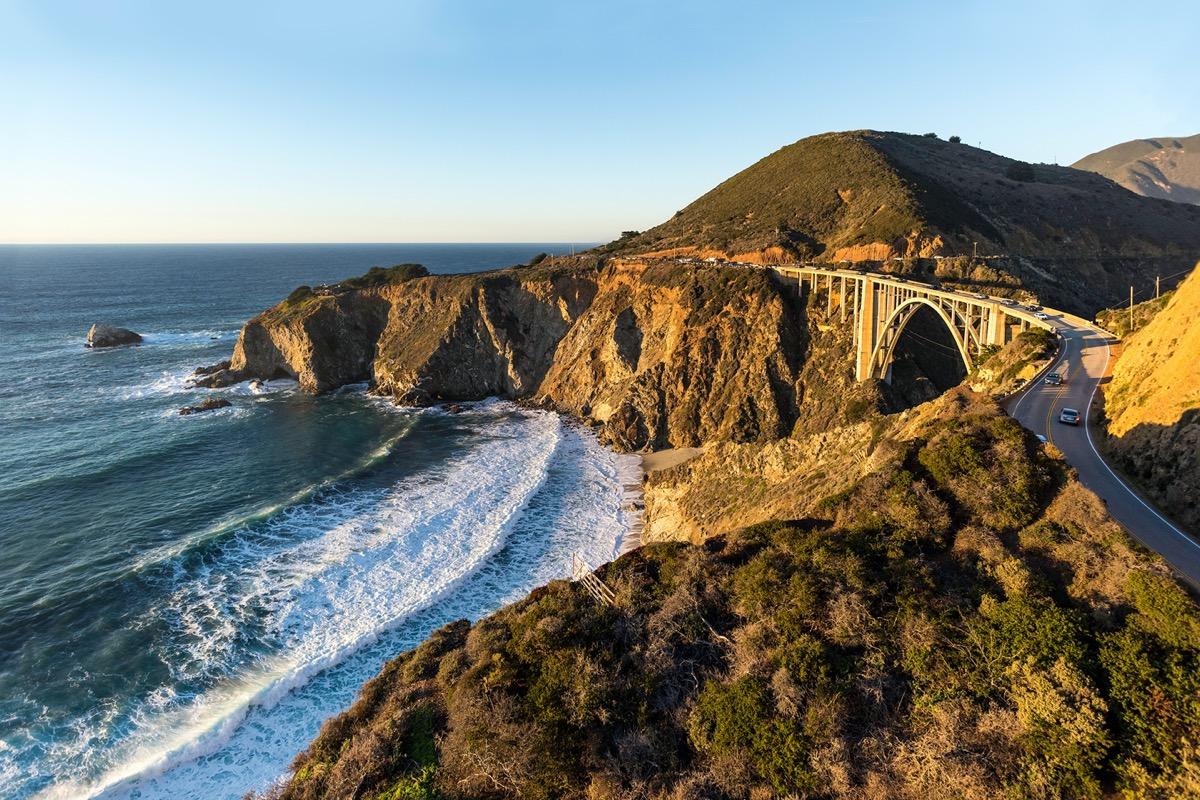 bridge between two cliffs along a coastline