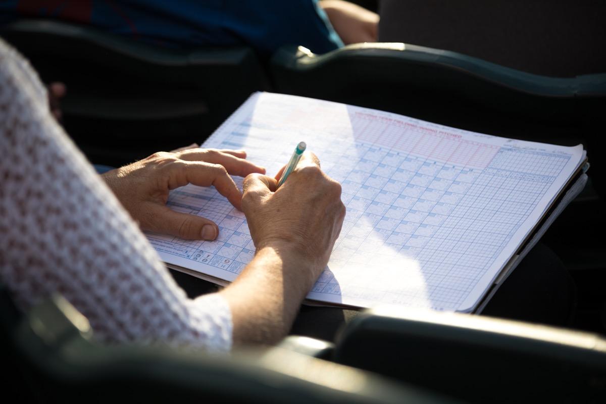 Woman updating a scorecard