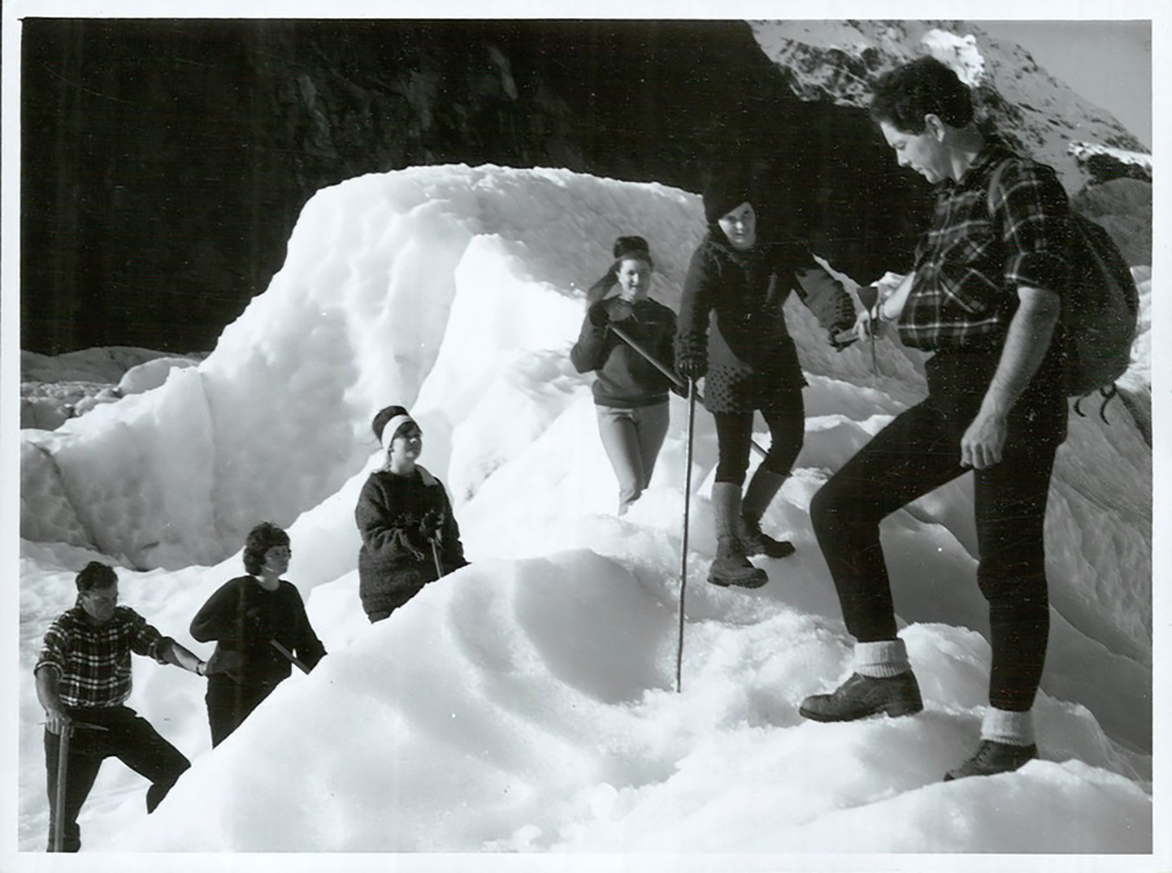 a group of travelers climb a glacier