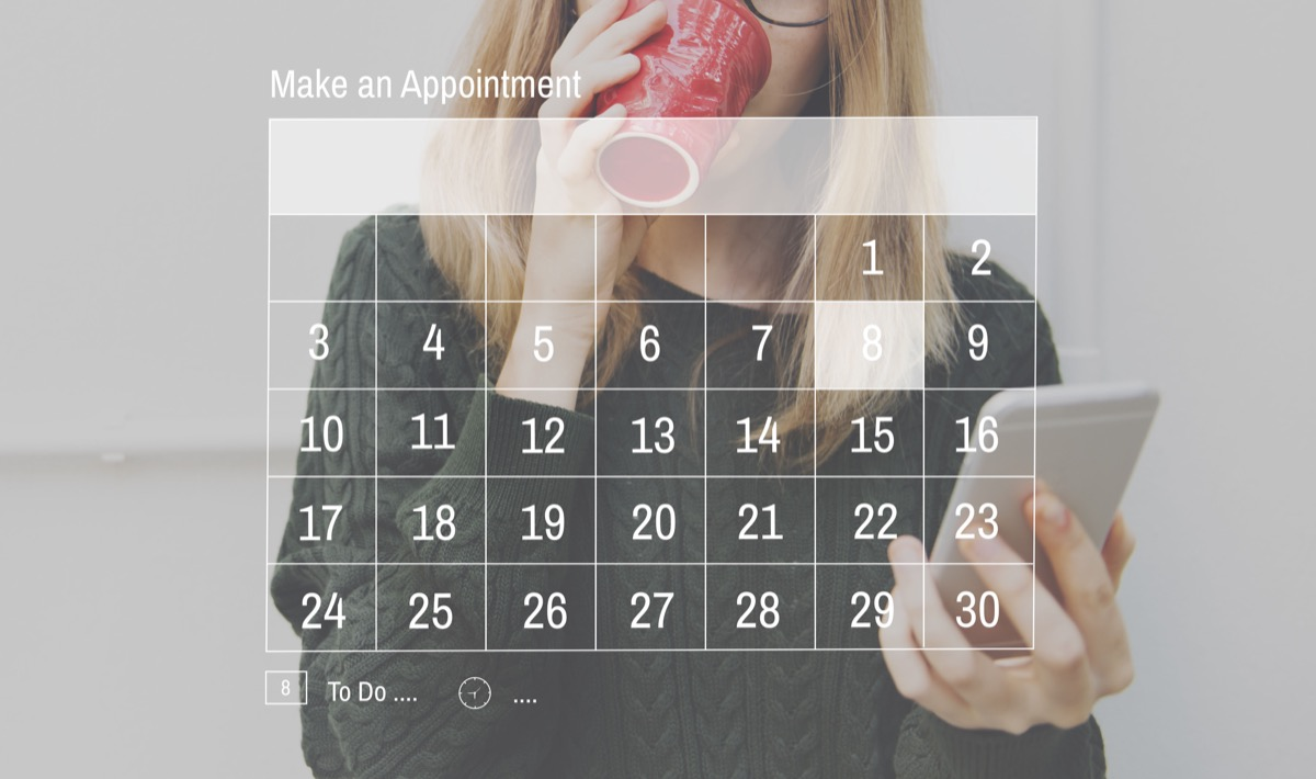 Woman drinking coffee and scheduling appointment