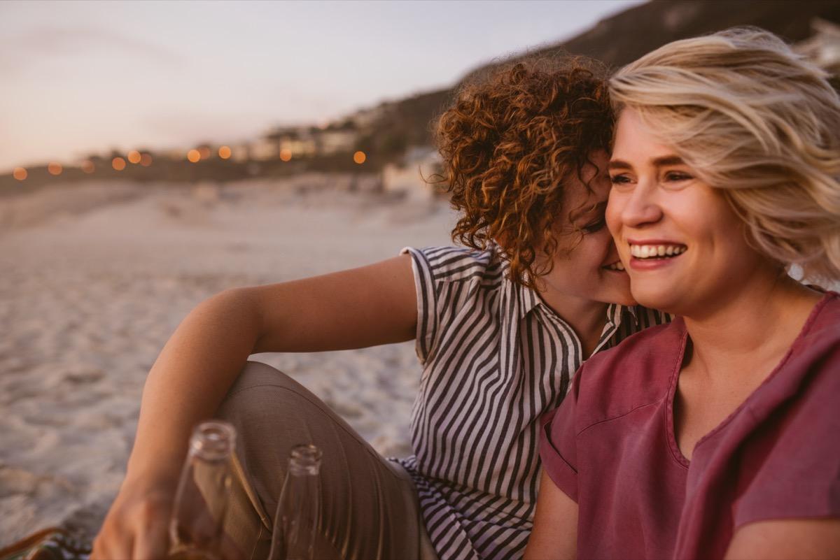 affectionate lesbian couple on beach