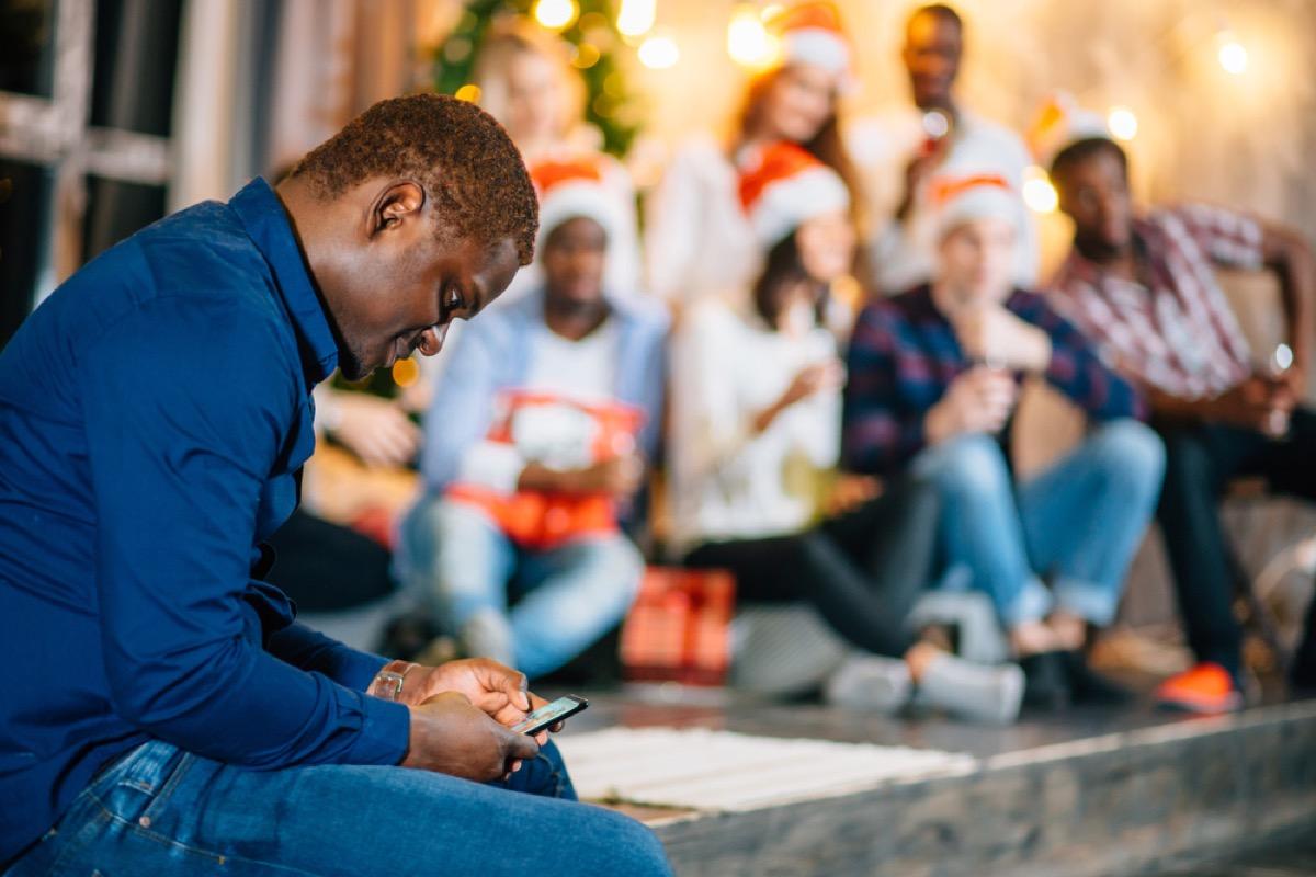 man alone at holiday party