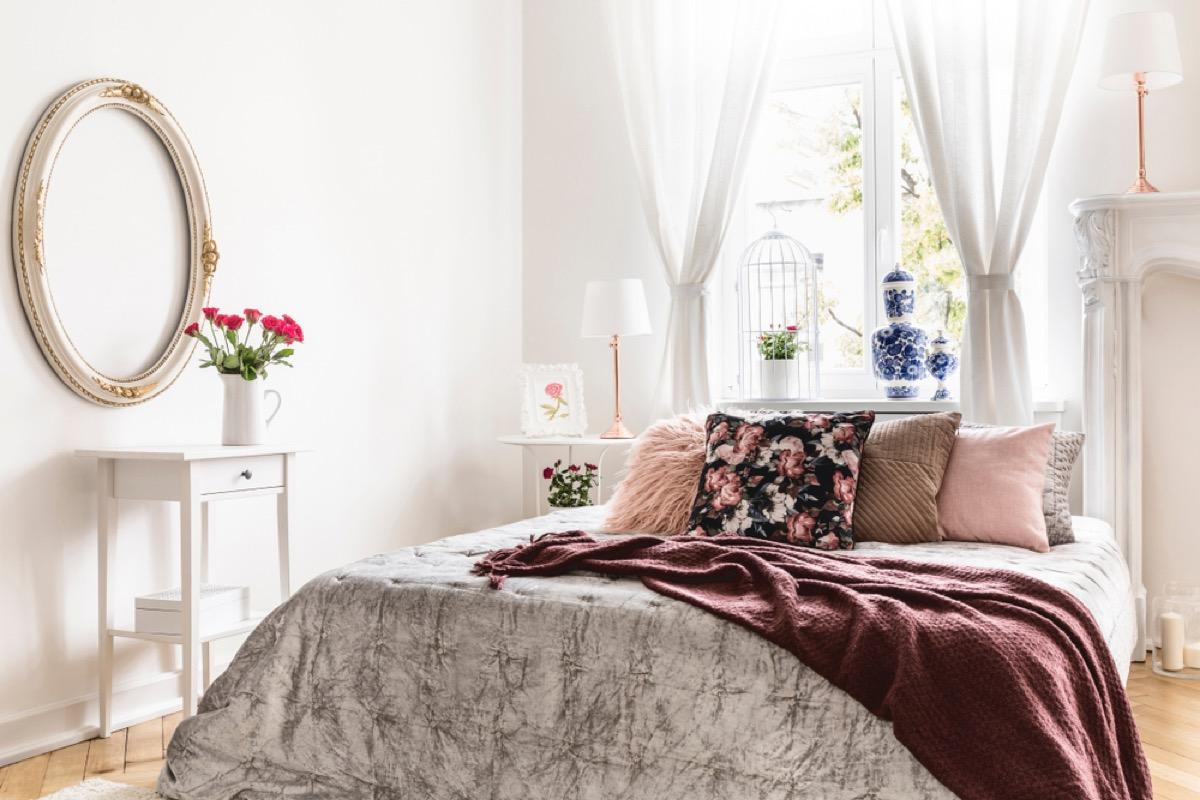 gray bedroom with brown velvet blanket