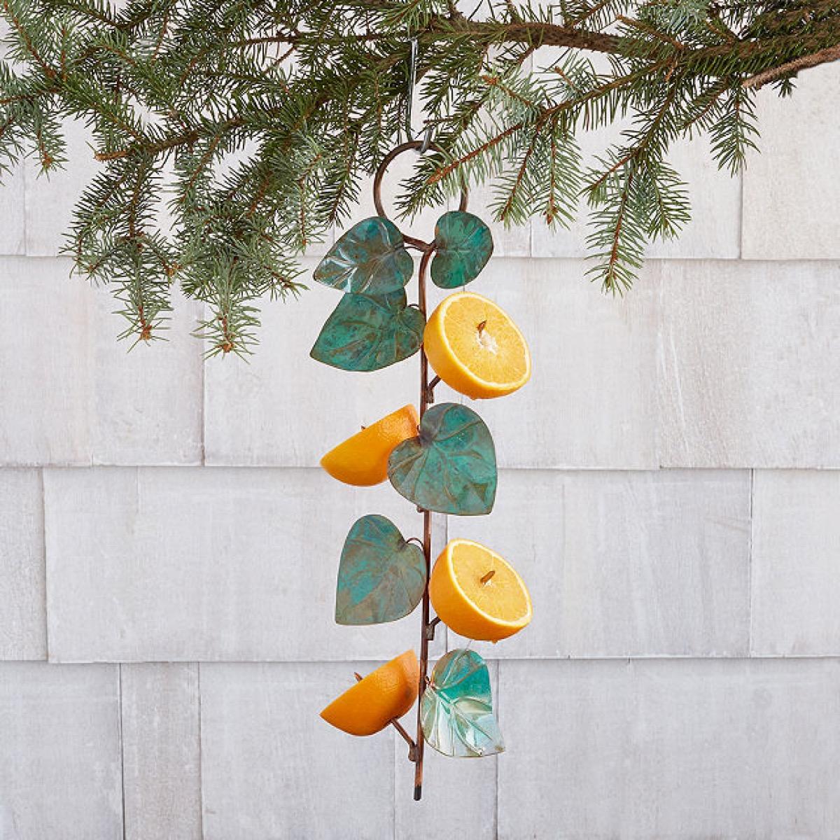 birdie fruit feeder with metal leaves and orange halves