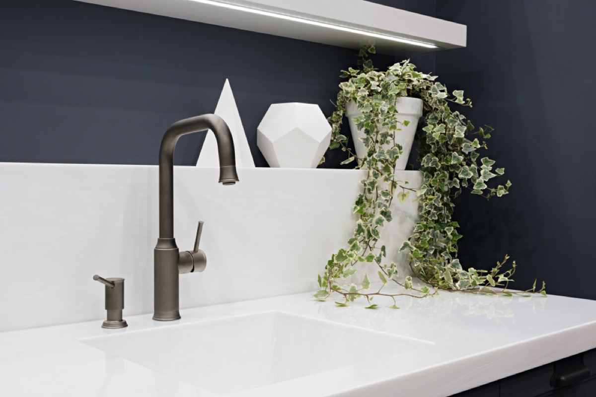 brushed metal faucet with white counter