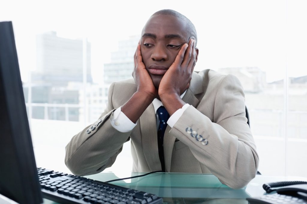 bored businessman looking at his computer