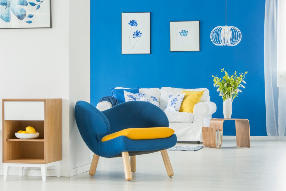 modern home with blue wall and blue chairs