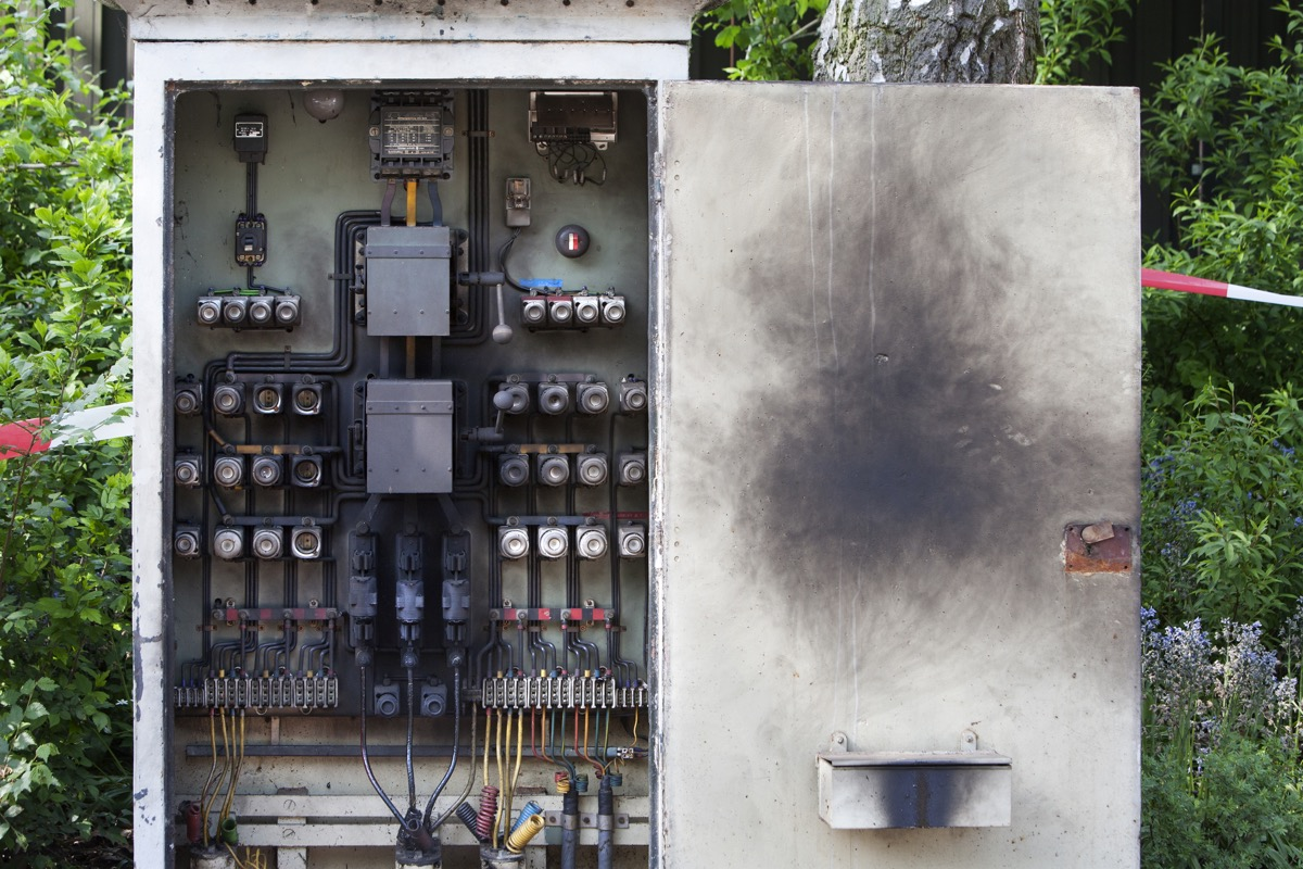 Blackened circuit board of an electrical cabinet
